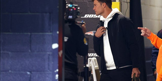 Tom Brady of the Tampa Bay Buccaneers walks to the locker room before a game against the New England Patriots at Gillette Stadium on October 03, 2021 in Foxborough, Massachusetts.