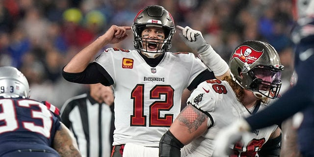 Tampa Bay Buccaneers quarterback Tom Brady (12) calls out a play at the line of scrimmage during the second half of an NFL football game against the New England Patriots, Sunday, Oct. 3, 2021, in Foxborough, Mass.