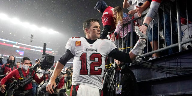 Tampa Bay Buccaneers quarterback Tom Brady (12) is congratulated by fans after defeating the New England Patriots 19-17 in an NFL football game, Sunday, Oct. 3, 2021, in Foxborough, Mass.