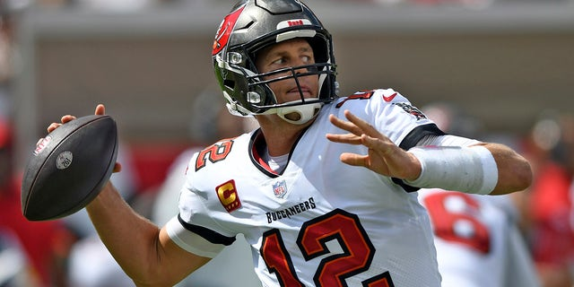 Tampa Bay Buccaneers quarterback Tom Brady (12) throws a pass against the Miami Dolphins during the first half of an NFL football game Sunday, Oct. 10, 2021, in Tampa, Florida.