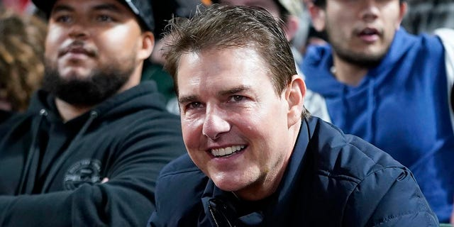 Actor Tom Cruise smiles during Game 2 of a baseball National League Division Series between the San Francisco Giants and the Los Angeles Dodgers Saturday, Oct. 9, 2021, in San Francisco.
