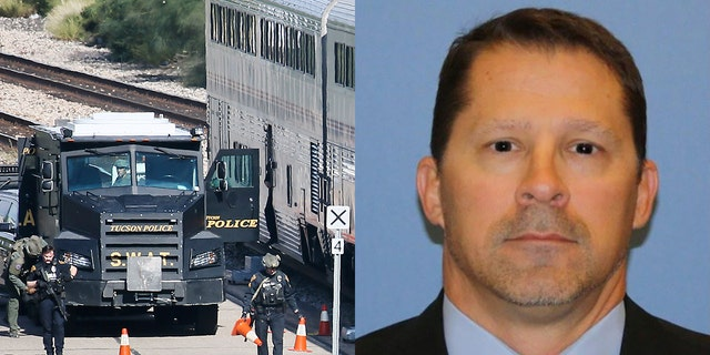 """A Tucson Police Department SWAT truck is parked near the last two cars of an Amtrak train in Tucson, Arizona, Monday after a shooting left DEA agent Michael """"Mike"""" Garbo dead (Associated Press, DEA)"""