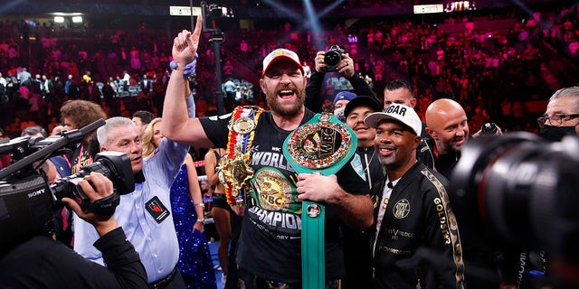 Tyson Fury, of England, celebrates after defeating Deontay Wilder in a heavyweight championship boxing match Saturday, Oct. 9, 2021, in Las Vegas.