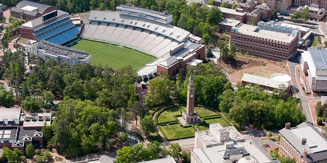CHAPEL HILL, NC - APRIL 21: An aerial view of the University of North Carolina campus including Kenan Stadium (left) and the Morehead-Patterson Bell Tower (center) on April 21, 2013 in Chapel Hill, North Carolina.