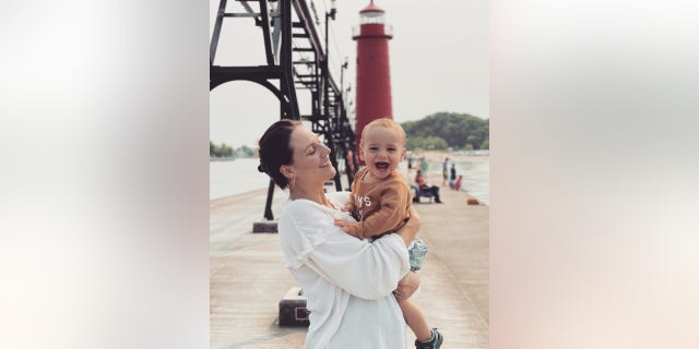 Vanessa Santos pictured on vacation with her son in Michigan,