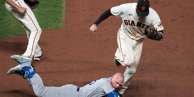 San Francisco Giants first baseman Wilmer Flores, top, forces Los Angeles Dodgers' Matt Beaty out at first during the ninth inning of Game 5 of a baseball National League Division Series Thursday, Oct. 14, 2021, in San Francisco.
