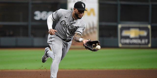 Chicago White Sox third baseman Yoán Moncada fields a ground ball by Houston Astros second baseman Jose Altuve during the third inning in Game 2 of an American League Division Series game Friday, Oct. 8, 2021, in Houston.