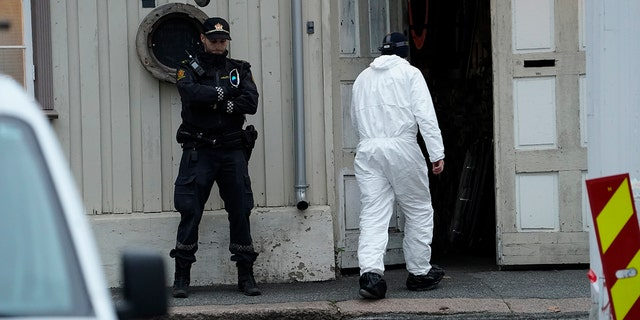 Police work near a site on Thursday after a man killed several people in Kongsberg, Norway.