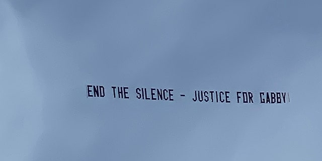 Justin Shepherd raised funds from his TikTok followers to fly this banner over Brian Laundrie's home in North Port, Fla.