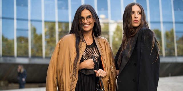 Demi Moore (L) and Scout Willis (R) attend attend the Stella McCartney Womenswear Spring/Summer 2022 show as part of Paris Fashion Week on October 04, 2021 in Paris, France.