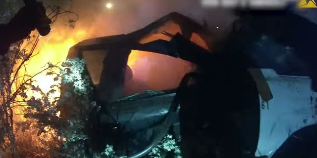 Police rescued an unconscious man from inside a burning vehicle that crashed in Garland, Texas, early Wednesday.