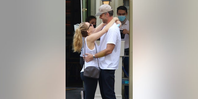 Parents-to-be Jennifer Lawrence and husband Cooke Maroney all look in love as they have a sweet PDA moment after lunch in midtown Manhattan.