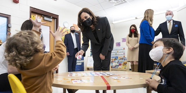 U.S. Vice President Kamala Harris plays bingo with children at Ben Samuels Children's Center at Montclair State University in Little Falls, New Jersey, U.S., on Friday, Oct. 8, 2021.