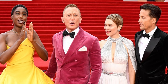 """(L-R) Lashana Lynch, Daniel Craig, Lea Seydoux, and Director Cary Joji Fukunga attend the World Premiere of """"No Time To Die"""" at the Royal Albert Hall on September 28, 2021 in London, England."""