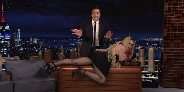 """Madonna wreaked havoc during her appearance on """"The Tonight Show"""" Thursday when she crawled across host Jimmy Fallon's desk and flashed her tush to the audience."""
