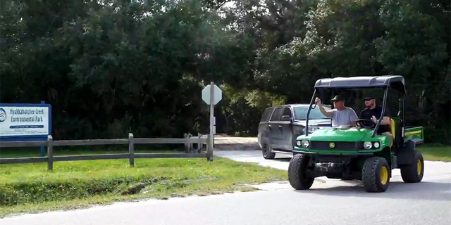Christopher Laundrie is seen being escorted by law enforcement at the Myakkahatchee Creek Environmental Park.