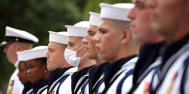 WASHINGTON, DC - SEPTEMBER 17: Members of the Navy Ceremonial Guard stand for the national anthem during a ceremony for National POW/MIA Recognition Day, at the U.S. Navy Memorial on September 17, 2021 in Washington, DC. The ceremony honored all military personnel who were prisoners of war or who are still missing in action. (Photo by Kevin Dietsch/Getty Images)