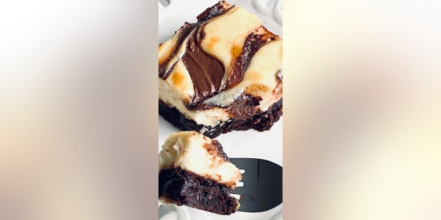 This decadent dessert is made with a brownie crust and a cheesecake topping with Nutella swirl.