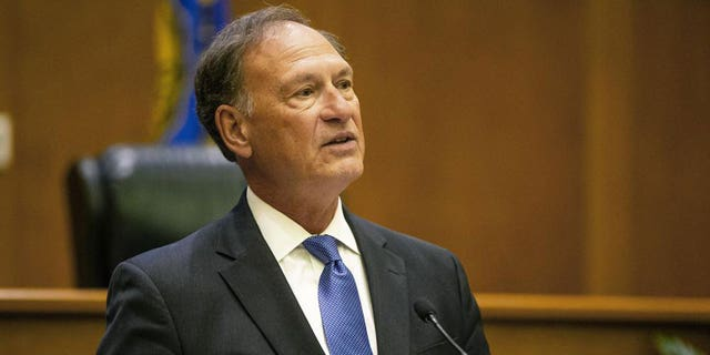 """Supreme Court Justice Samuel Alito addresses the audience during the """"The Emergency Docket"""" lecture Thursday, Sept. 30, 2021, in the McCartan Courtroom at the University of Notre Dame Law School in South Bend, Indiana. (Michael Caterina /South Bend Tribune via AP)"""