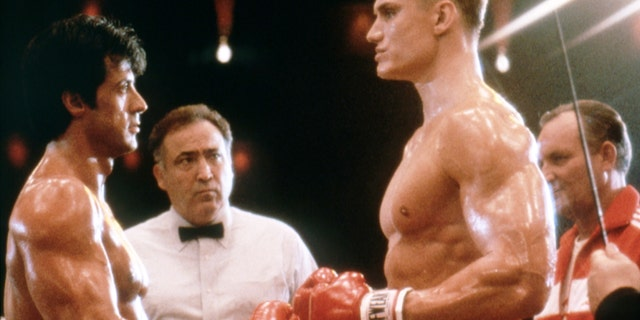 """Swedish actor Dolph Lundgren (R) with American actor, director and screenwriter Sylvester Stallone (L) on the set of his movie """"Rocky IV."""""""
