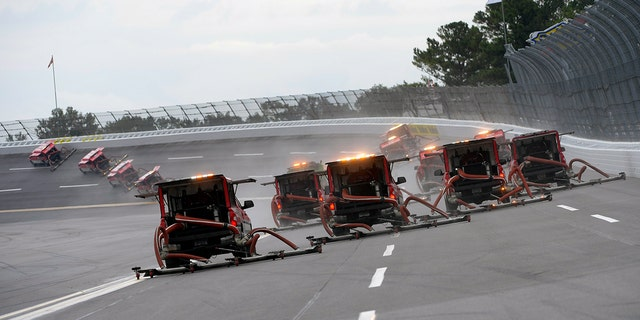 NASCAR attempted to dry the Talladega track with its Air Titan blower trucks.