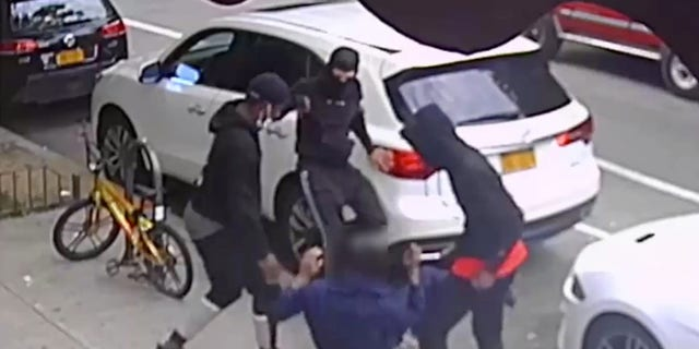 Photo of trio of assailants stabbing a victim, photo courtesy of the NYPD's DCPI.