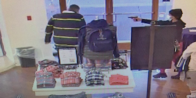 An armed suspect pointed a handgun at a store employee who confronted him, authorities said.