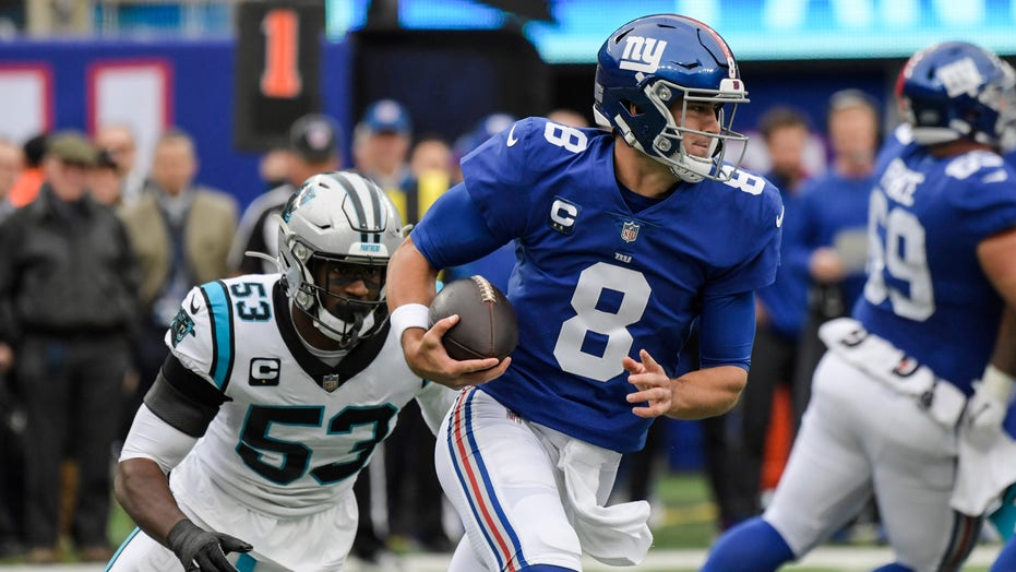 Jones passing and catching, Giants D spark win over Panthers