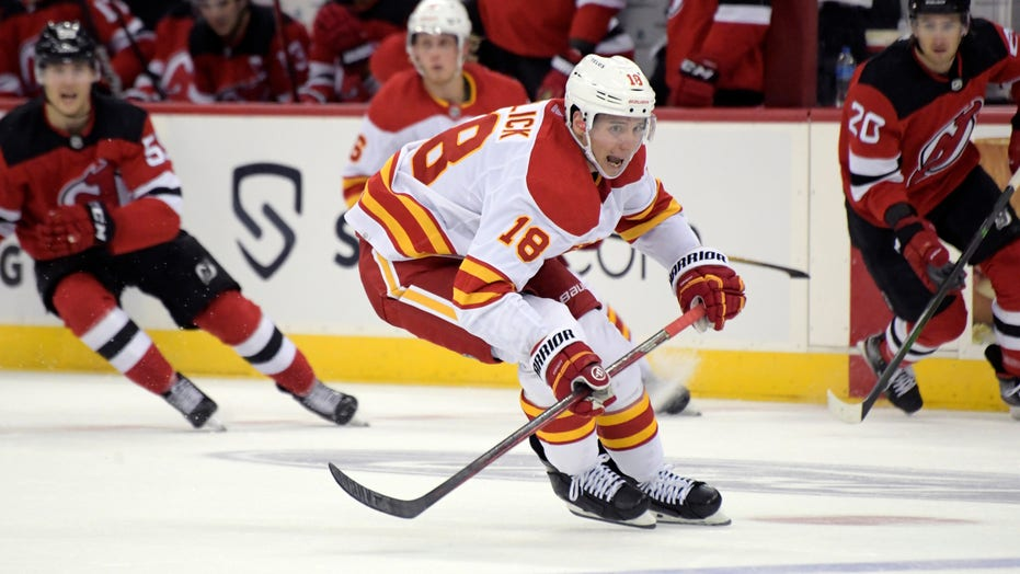 Flames use 4-goal outburst in 1st period to beat Devils 5-3