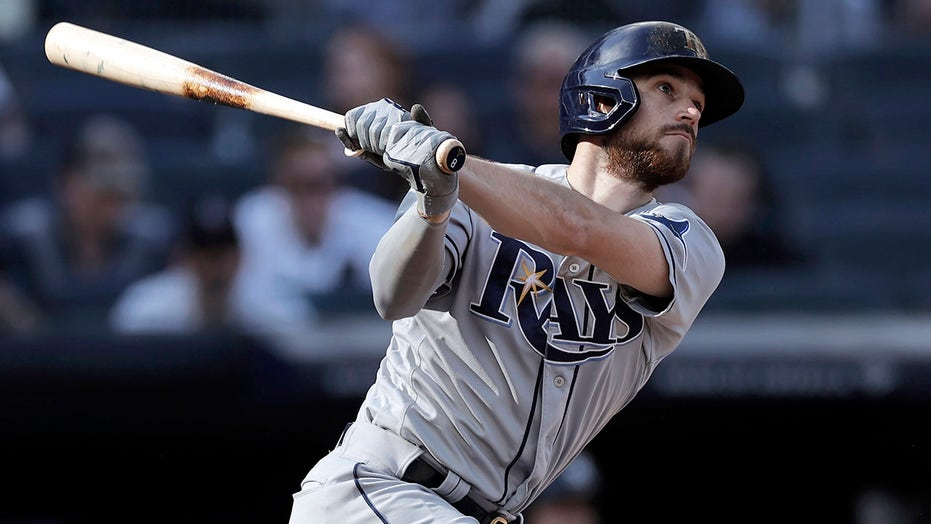Lowe hits 3 HRs, Rays roll 12-2 to prevent Yankees WC clinch
