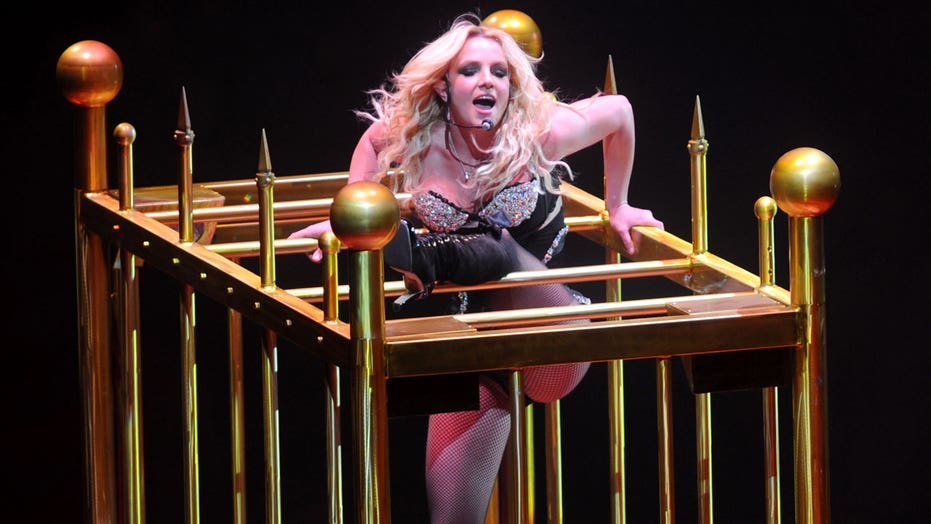 Britney Spears says she felt like a 'caged animal' for 'half' of her life as she dances to unreleased single