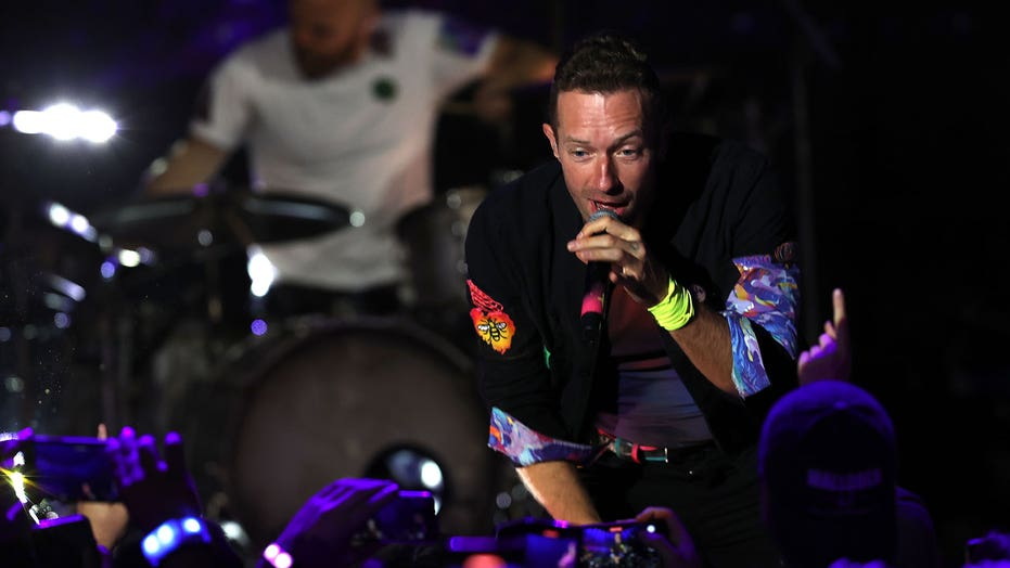 Chris Martin honors girlfriend Dakota Johnson during Coldplay concert: 'This is about my universe'