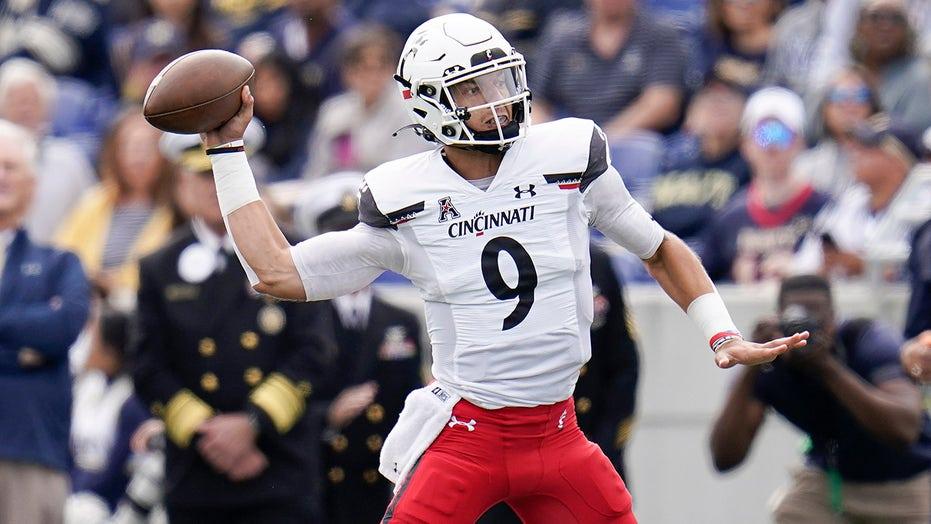 No. 2 Cincinnati stays unbeaten with 27-20 win over Navy