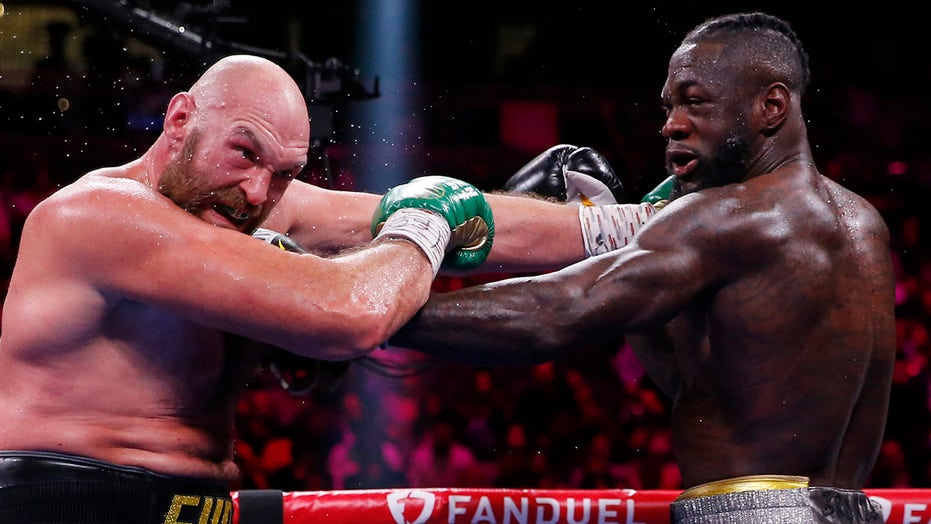 Tyson Fury knocks out Deontay Wilder in classic heavyweight war to retain titles
