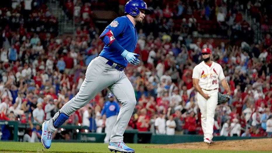 Happ's home run caps comeback as Cubs stun Cardinals 6-5