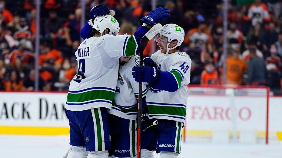 Canucks score twice in shootout, beat Flyers 5-4
