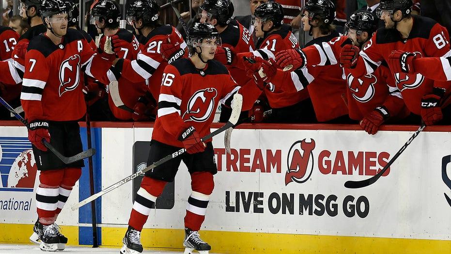Hughes scores 2, lifts Devils past Blackhawks in OT