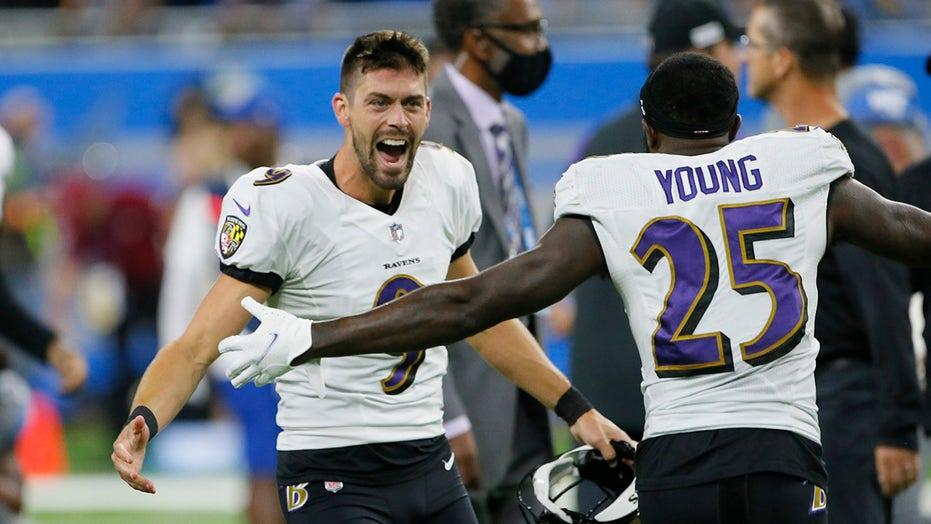 Ravens' record-setting Tucker embraces the spotlight