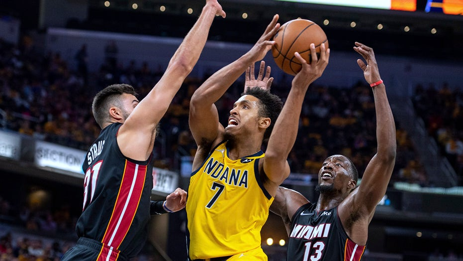 Brissett helps Pacers pull away from Heat in overtime