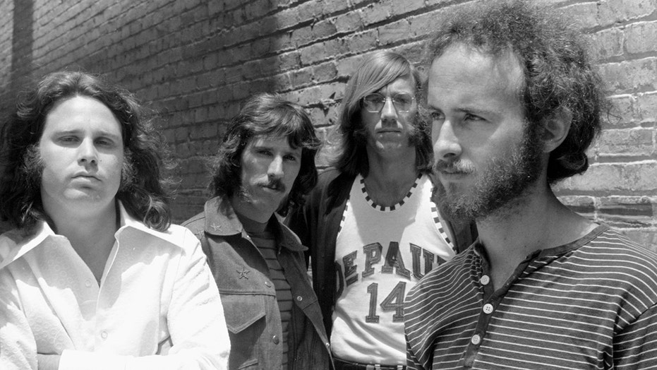 The Doors' Jim Morrison had 'a fascination with death' before passing away at 27, bandmate Robby Krieger says