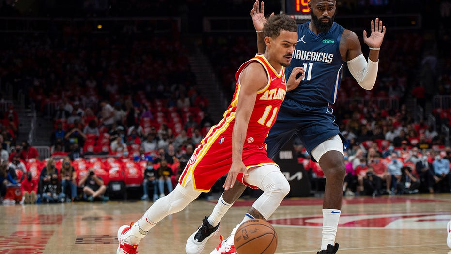 Young, Hawks open season with 113-87 rout of Mavericks