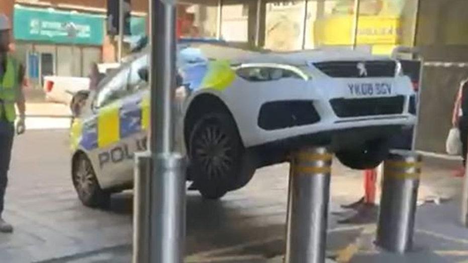 Cop car gets a lift after poor parking job