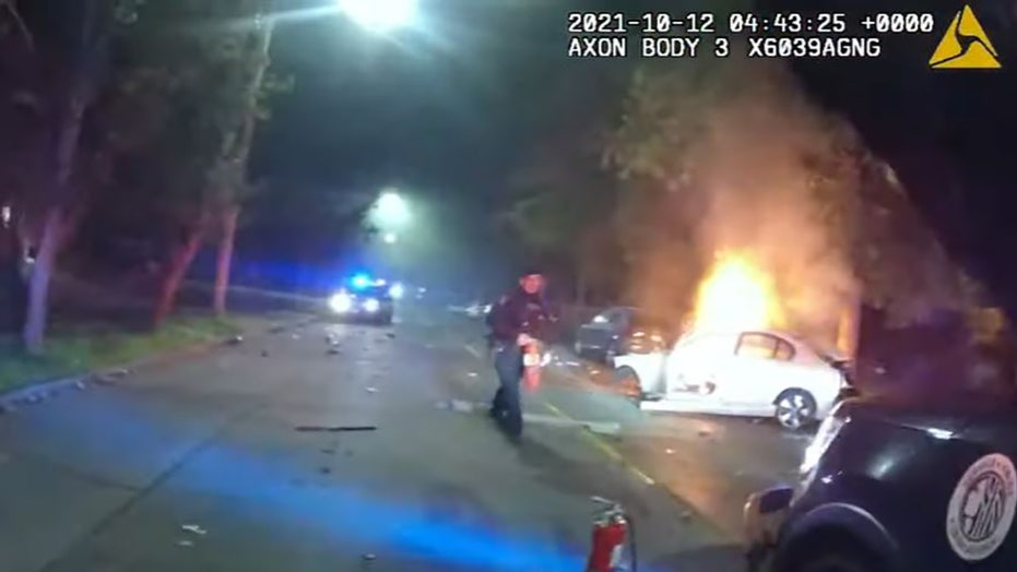 Seattle police rescue convicted felon from wrecked car before flames engulf vehicle, bodycam video shows