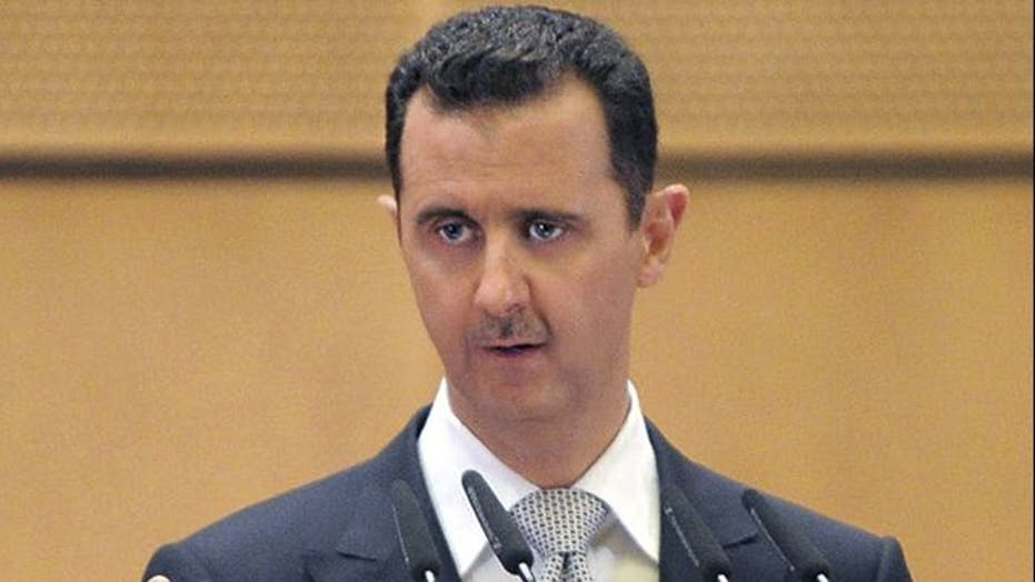 Syria's President Vows 'Iron Hand' Against Protesters