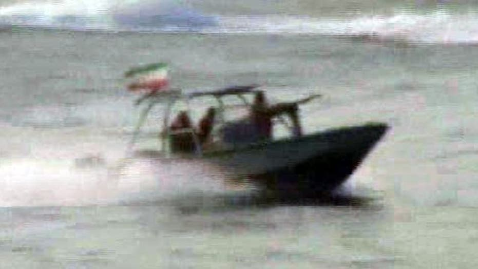 Iranian boats approach USS New Orleans