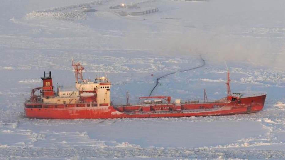Russian tanker offloads fuel to snow-covered town
