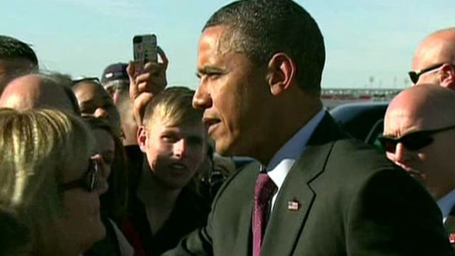 Obama takes populist pitch on the road