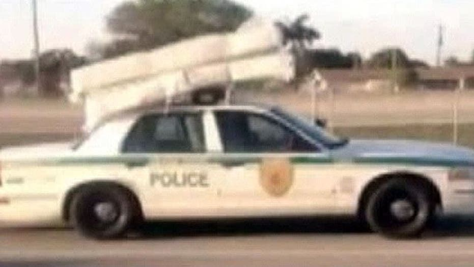 Cop spotted transporting mattress, box spring with car