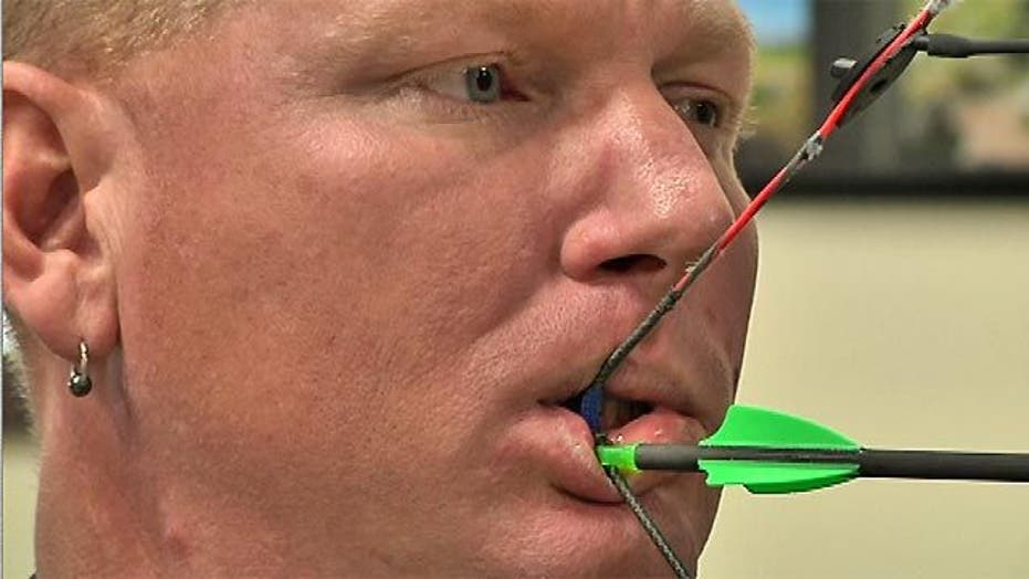 Paralympic Archer Fires Arrows with Teeth