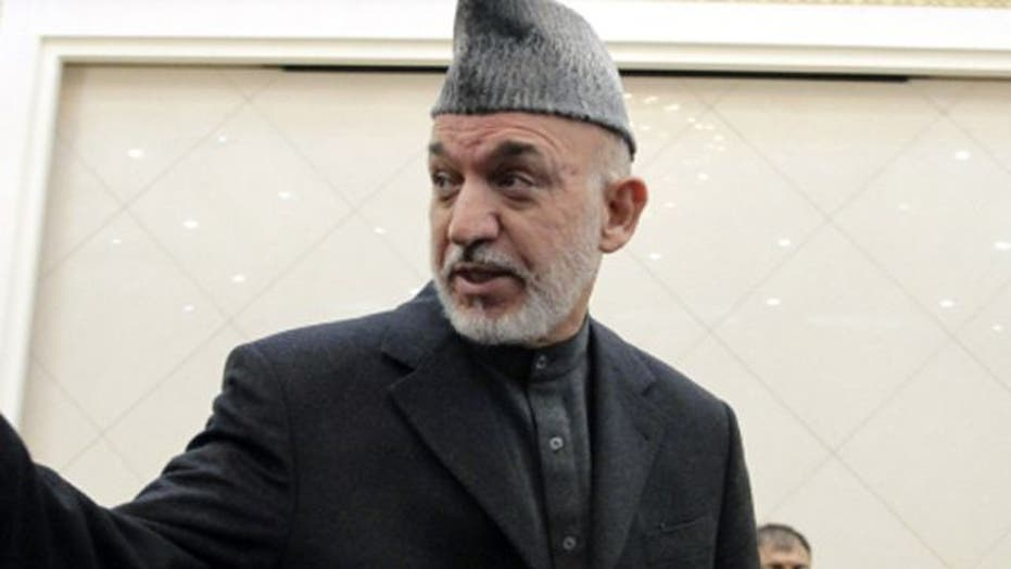 Karzai accuses US of not cooperating over rampage